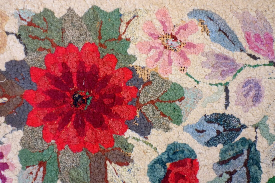Floral hooked rug with rectangular border - very good - 2