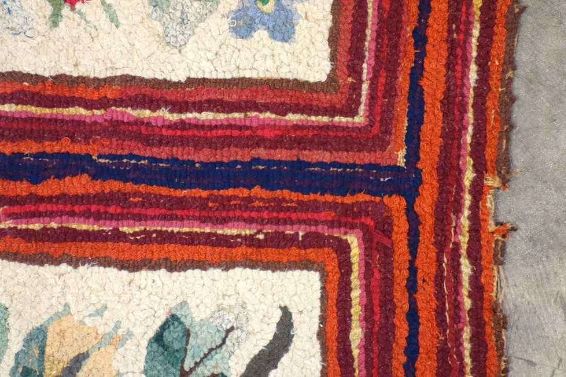 Floral hooked rug with rectangular border - very good - 3