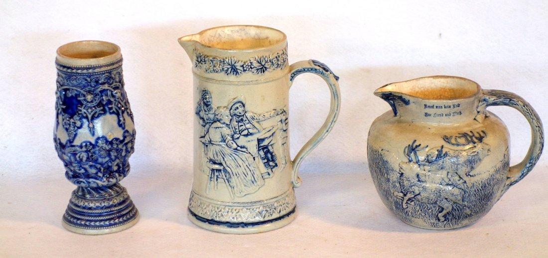 Three German stoneware items including milk pitcher