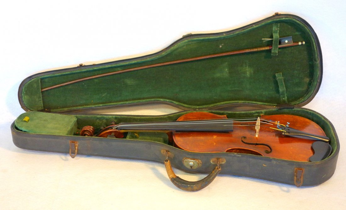 Maple violin, bow and hard case. The violin has a paper