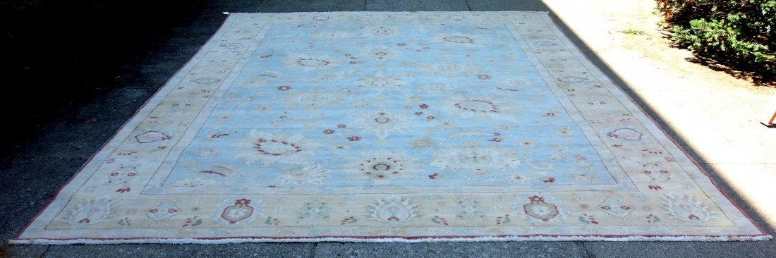 Large room size oriental style rug in light pastel