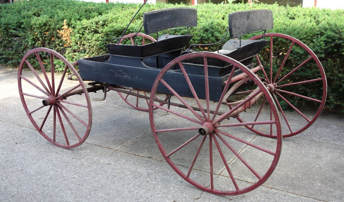 Old 2 seat buckboard wagon with 2 seats and wooden