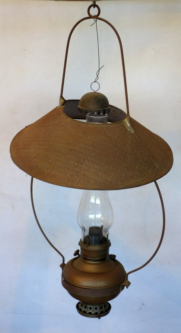 Country store hanging oil lamp with tin shade and smoke