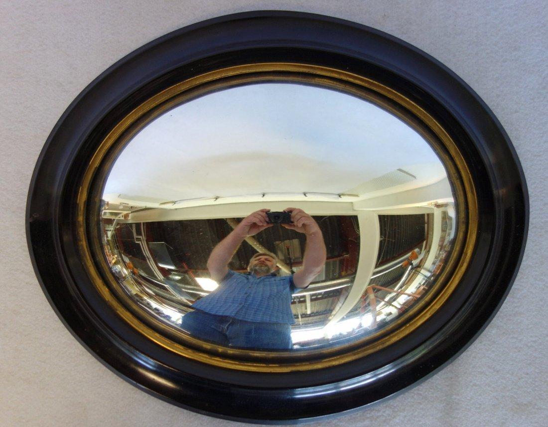 Convex oval wall mirror with mahogany or walnut frame