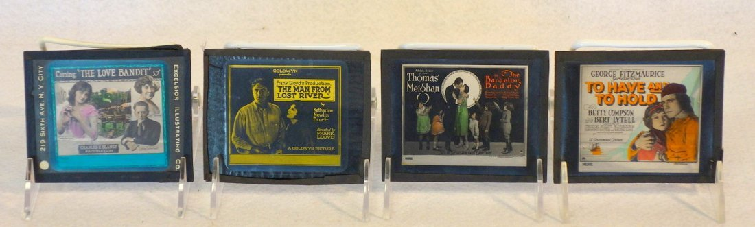 Grouping of 19 glass slides of old movie posters some - 6