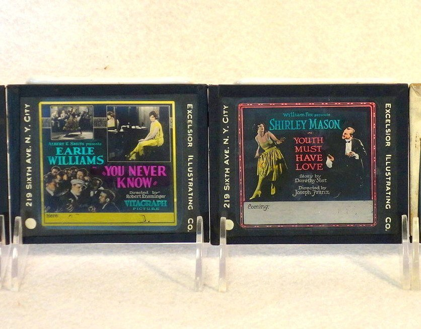 Grouping of 19 glass slides of old movie posters some - 8