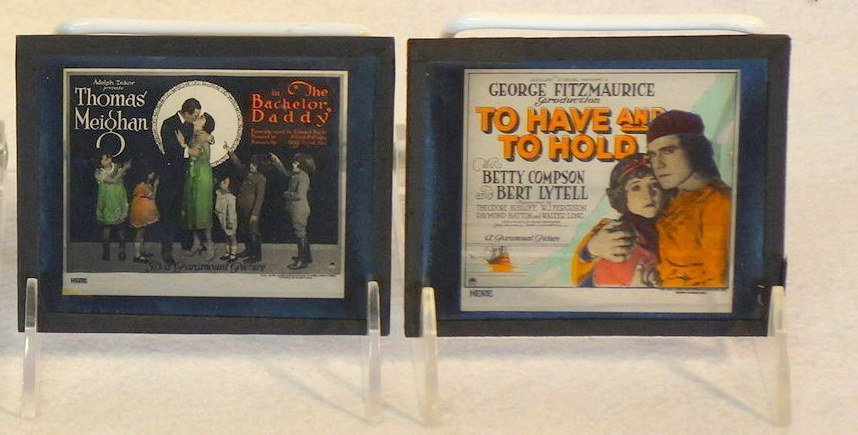 Grouping of 19 glass slides of old movie posters some - 9