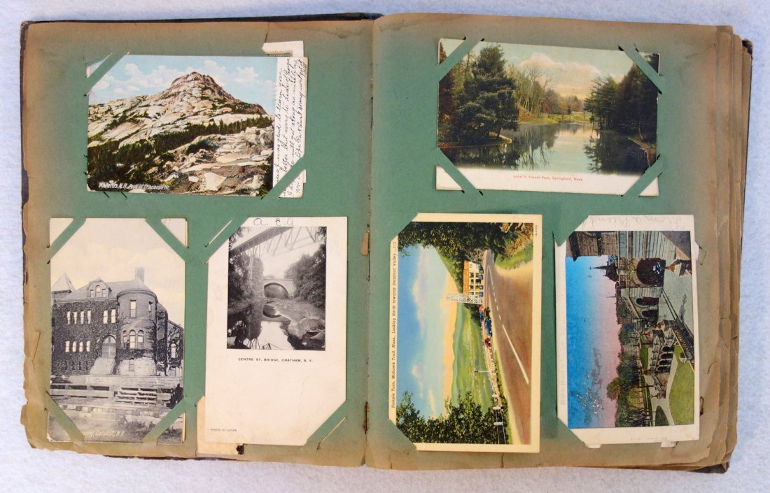 Grouping of ephemera. Includes post card album with - 3