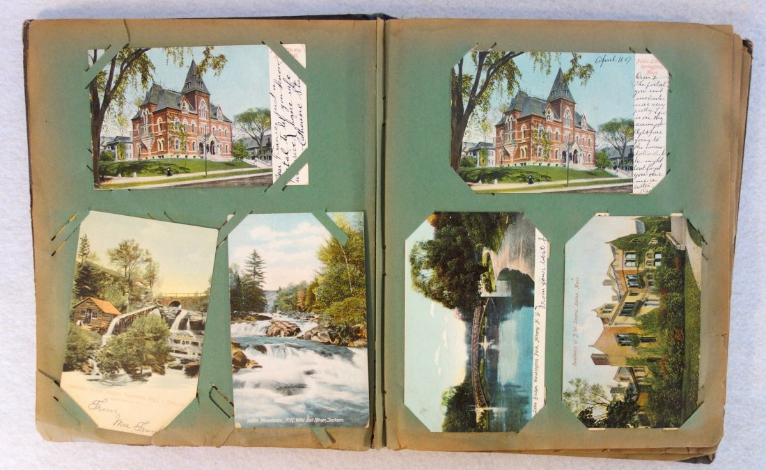 Grouping of ephemera. Includes post card album with - 4