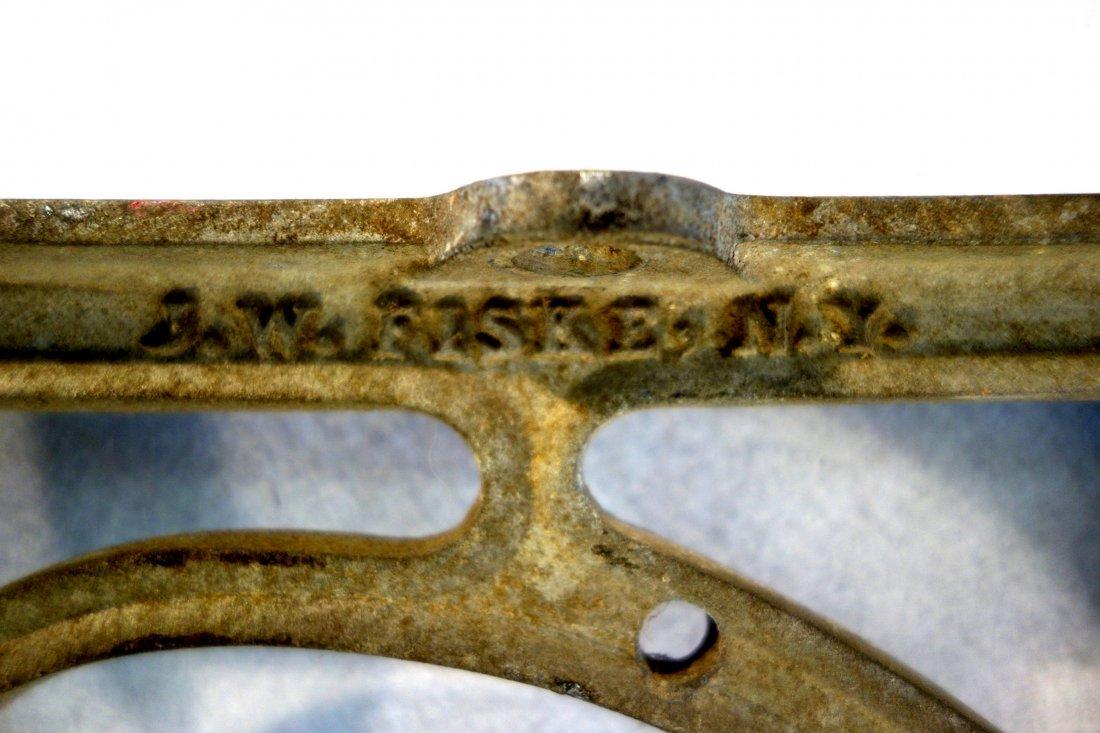 Old cast zinc saddle or sign holder signed J.W. Fiske - 2