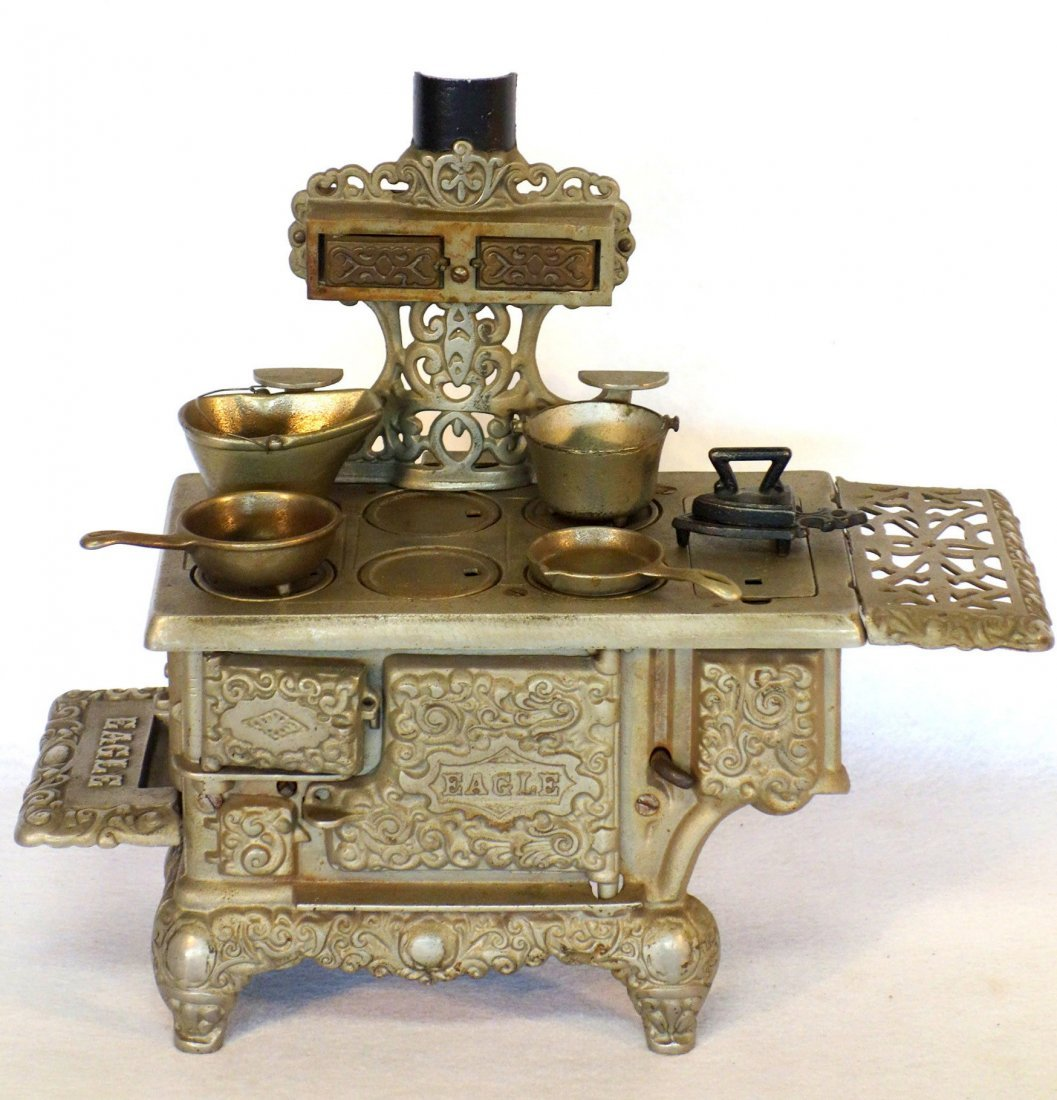 Large ornate nickel plated doll stove signed Eagle -