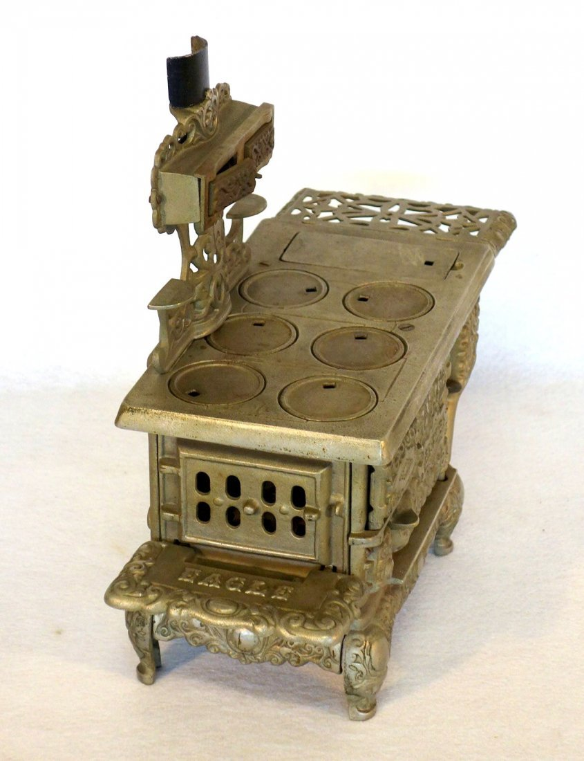 Large ornate nickel plated doll stove signed Eagle - - 3