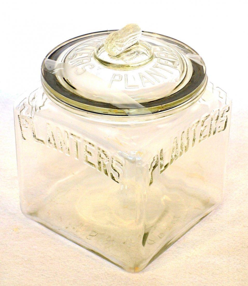 A Panter's Peanut glass jar with peanut finial - - 2