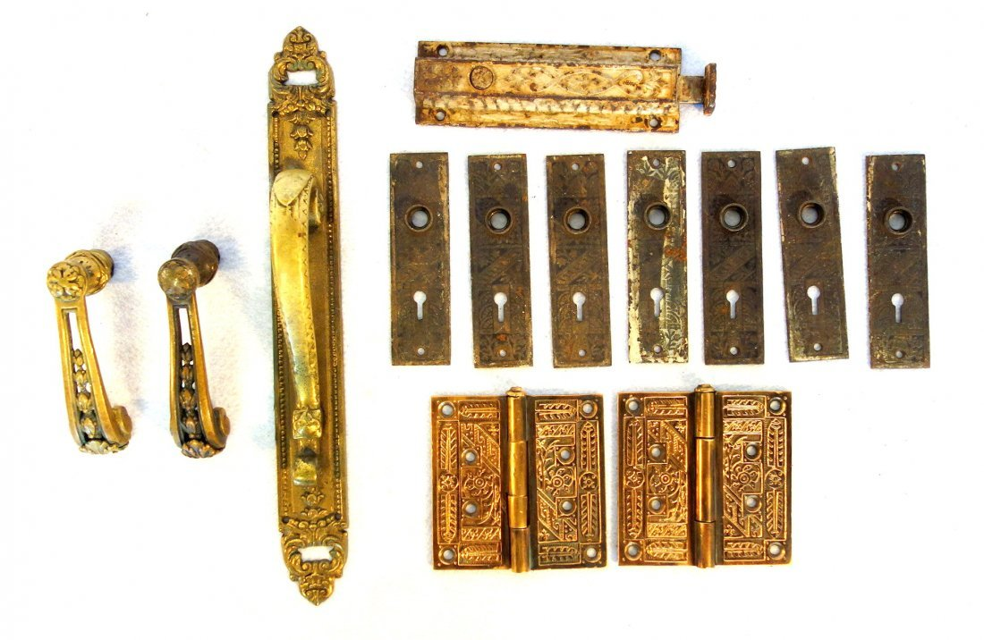 Grouping of Victorian door hardware including pair of