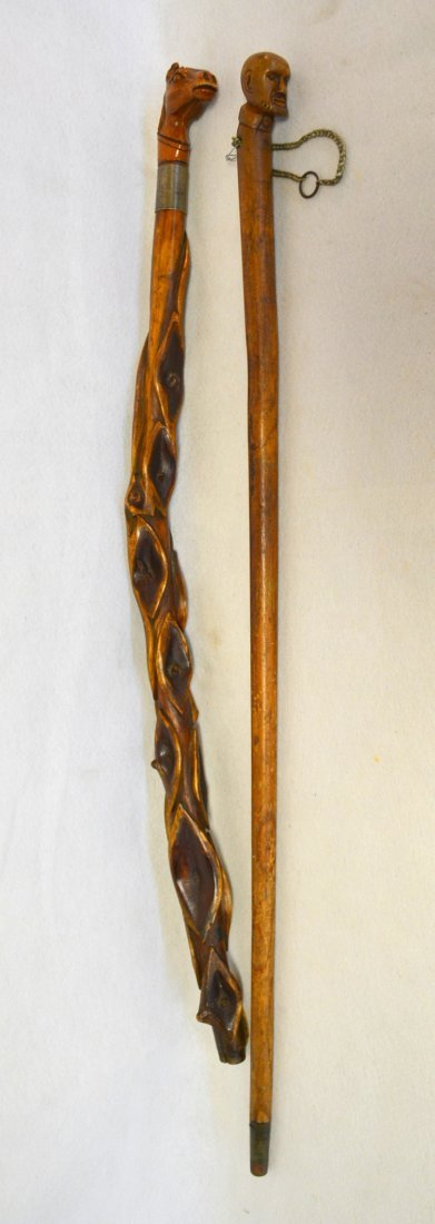 Two carved figural walking sticks including one with - 2