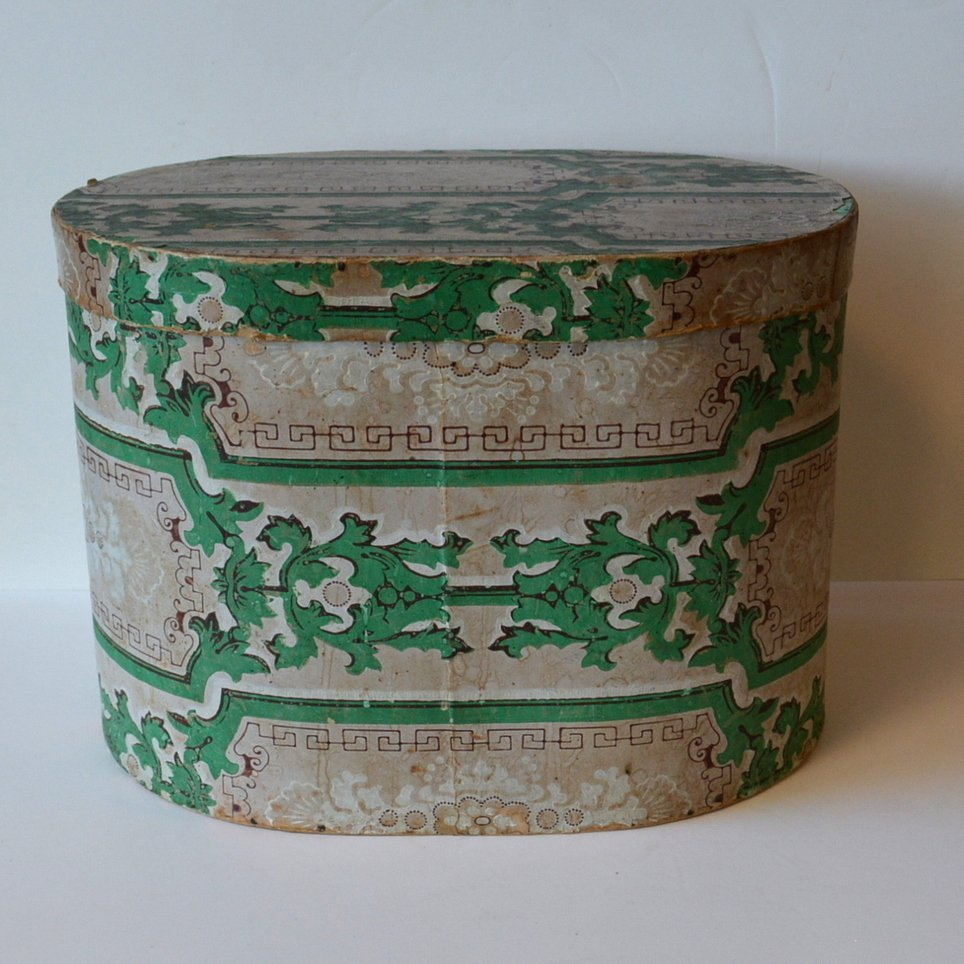 Old wall papered band box lined with 1847 newspaper