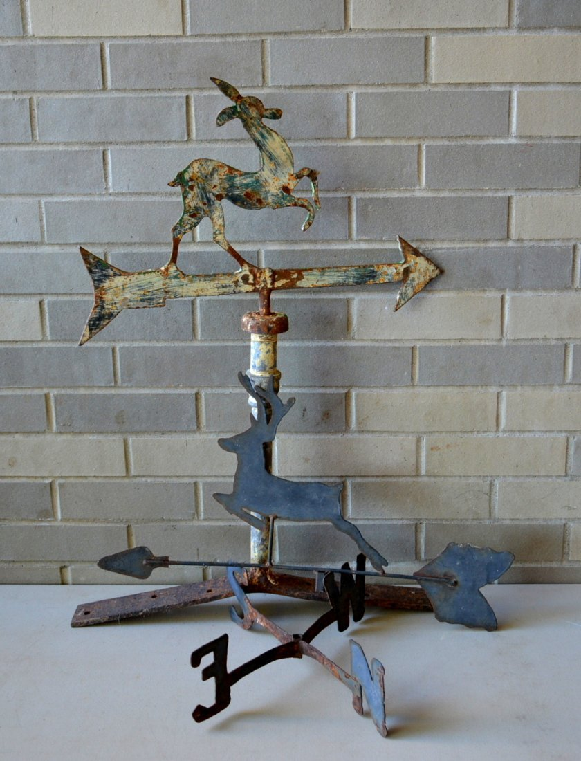 Two silhouette iron and tin deer weathervanes. The