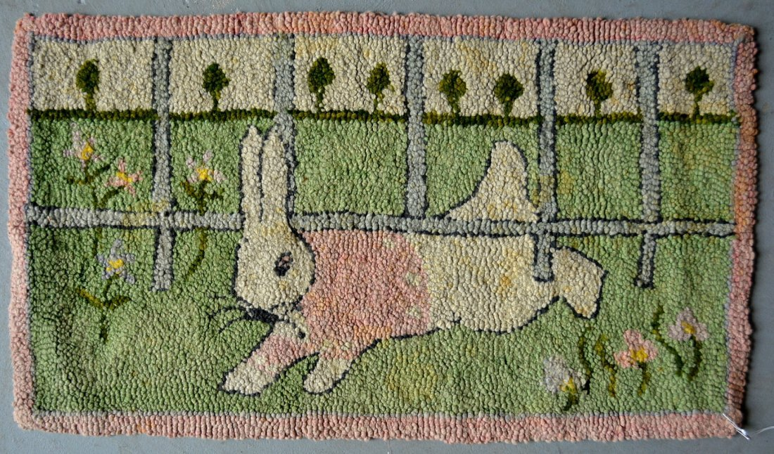Whimsical pictorial hooked rug of a rabbit crawling