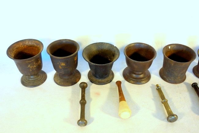 Grouping of 8 early cast iron mortars and 5 pestles. - 2