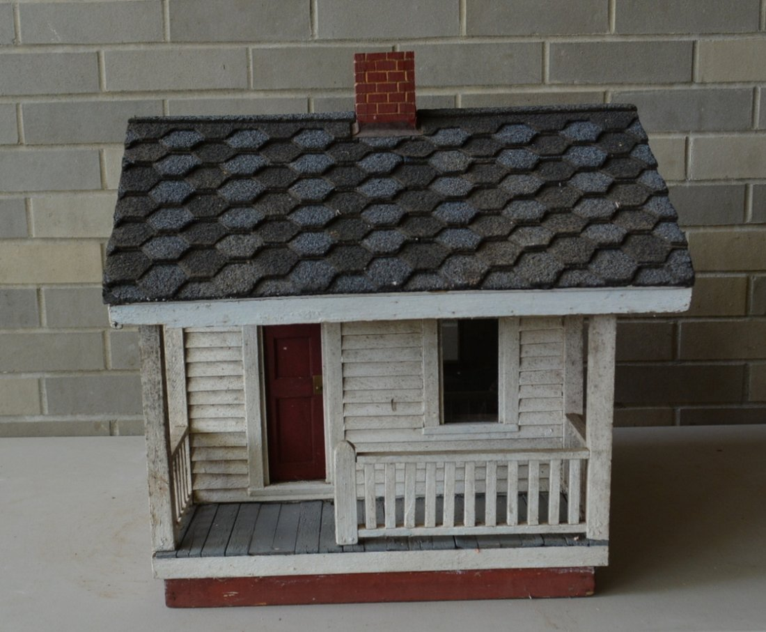 Old cottage model with clapboard siding, front porch