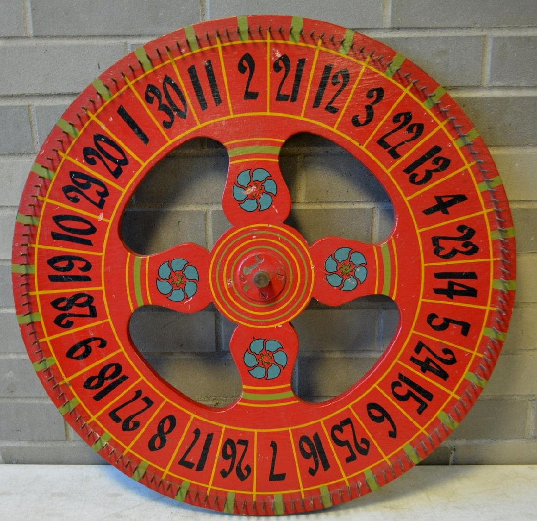 Hand painted game wheel in red, green, blue and black