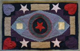 Hooked rug decorated with stars  geometric designs