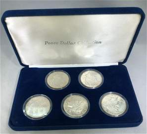 5 QTY PEACE DOLLARS IN DISPLAY CASE