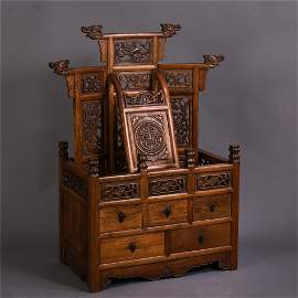 AN UNUSUAL CHINESE HARDWOOD CARVED CABINET