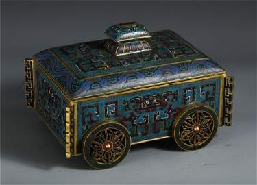A CHINESE CLOISONNE BEAST PATTERN CAR SHAPED TABLE ITEM