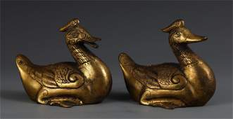 A PAIR OF DUCK SHAPED GILT BRONZE TABLE ITEM