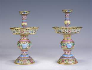 A PAIR OF CHINESE FAMILLE ROSE PORCELAIN CANDLE HOLDERS