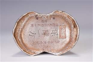 A CHINESE SILVER INGOT