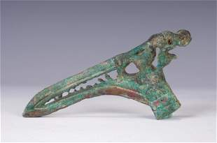 A CHINESE CARVED BRONZE WEAPON