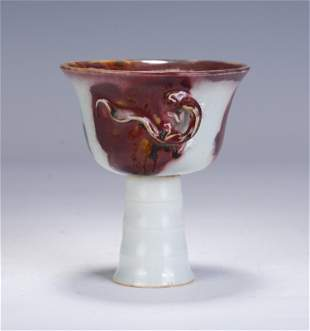 A CHINESE UNDERGLAZE RED GLAZED PORCELAIN STEM CUP