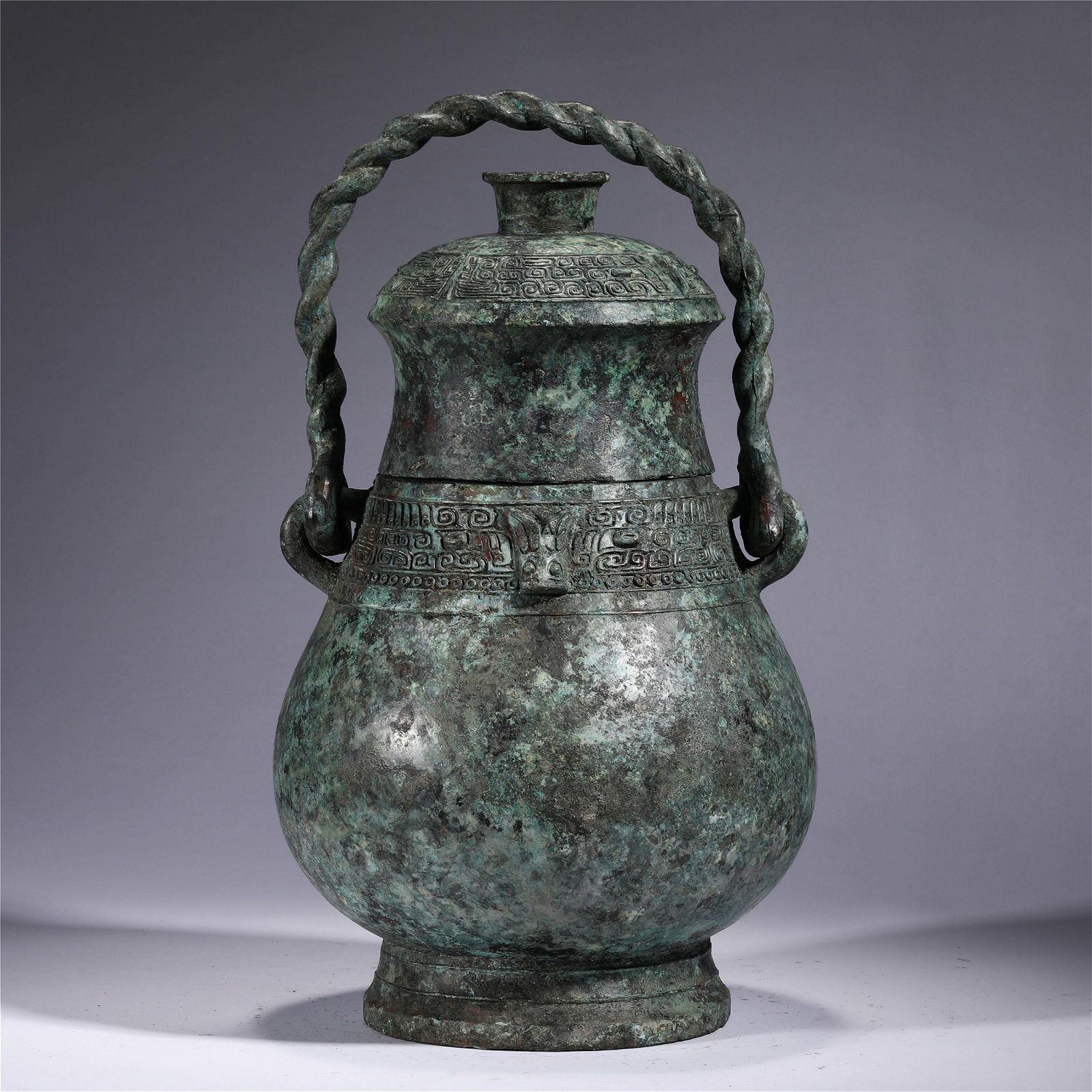 A CHINESE BRONZE WARE LONG HANDLE POT