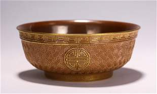 A CHINESE CORAL GLAZED PORCELAIN BOWL