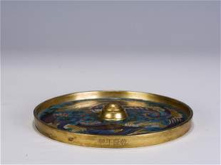 A CHINESE ENAMEL AND GILT BRONZE MIRROR