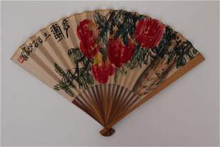 A CHINESE FOLDING FAN WITH COLORFUL PAINTING PEACHES
