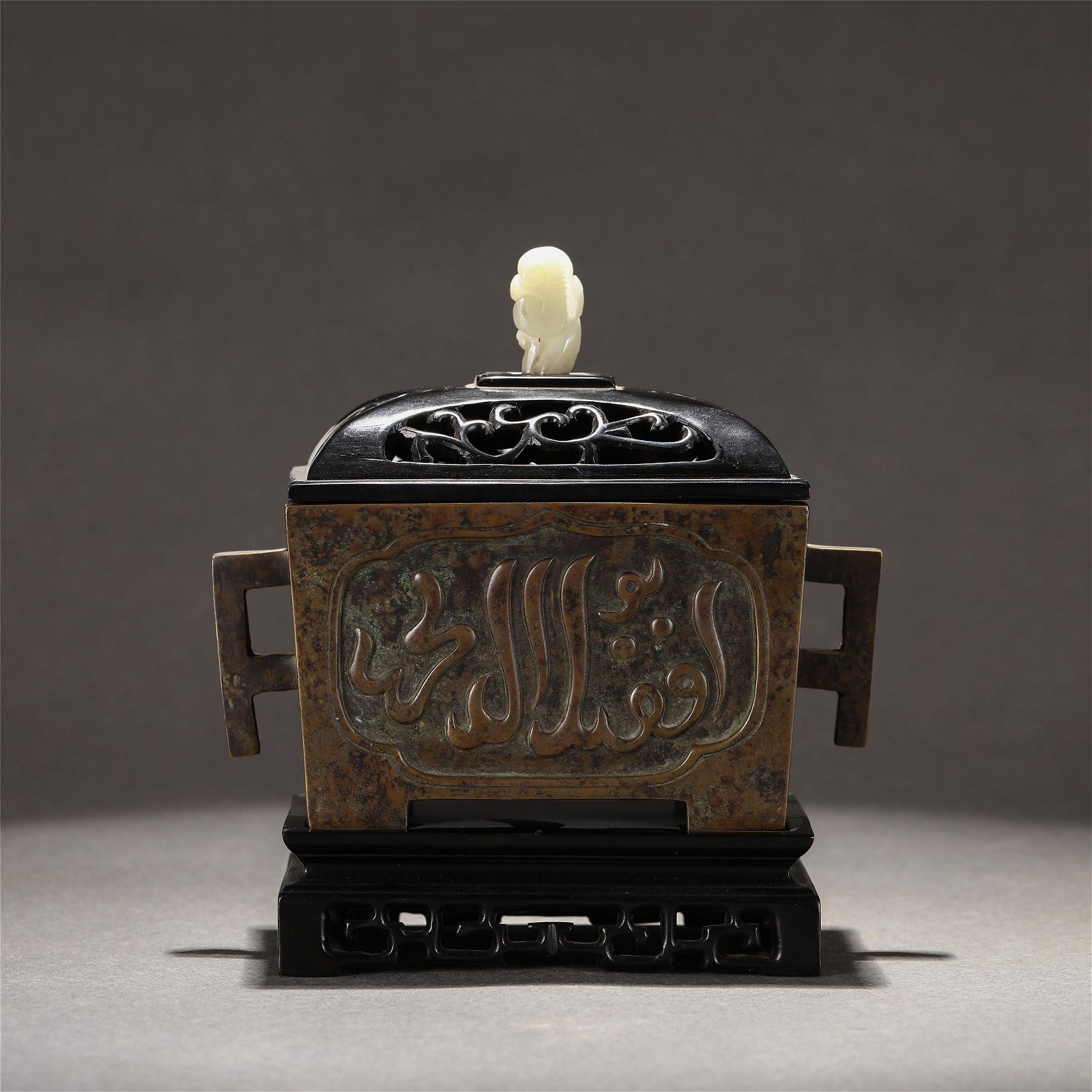 A CHINESE DOUBLE HANDLE BRONZE CENSER WITH COVER