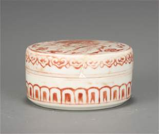 A CHINESE IRON RED GLAZED PORCELAIN LIDDED BOX WITH