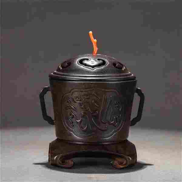 A CHINESE DOUBLE HANDLE BRONZE ROUND CENSER WITH COVER
