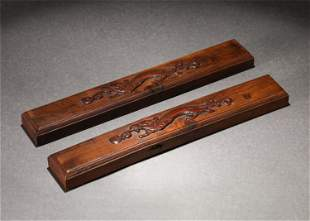 A PAIR OF CHINESE CARVED DRAGON BOXWOOD PAPER WEIGHT