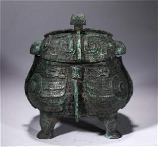 A CHINESE BRONZE FOO-DOG PATTERN CENSER WITH COVER