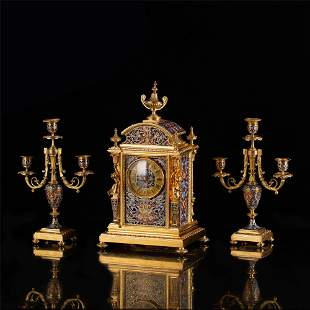 A FRENCH BRONZE ENAMEL MECHANICAL CLOCK AND