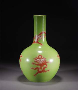 A CHINESE GREEN GROUND IRON RED GLAZED PORCELAIN VASE
