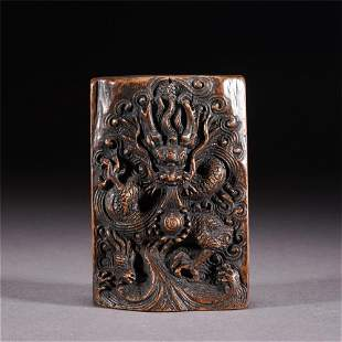 A CHINESE CARVED DRAGON PATTERN AGARWOOD SQUARE PLAQUE
