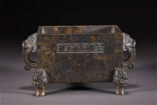 A CHINESE DOUBLE BEAST HANDLE BRONZE FOUR-FEET CENSER