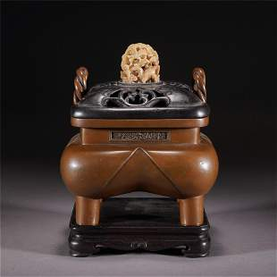 A CHINESE BRONZE FOUR-FEET CENSER WITH COVER