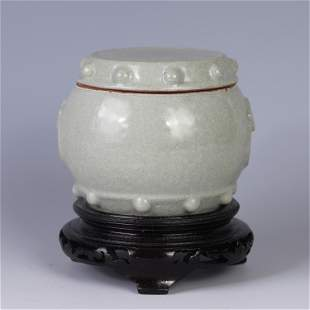 A CHINESE CELADON GLAZED PORCELAIN JAR WITH COVER