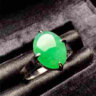 A CHINESE CERTIFIED NATURAL GREEN JADEITE WOMENS RING